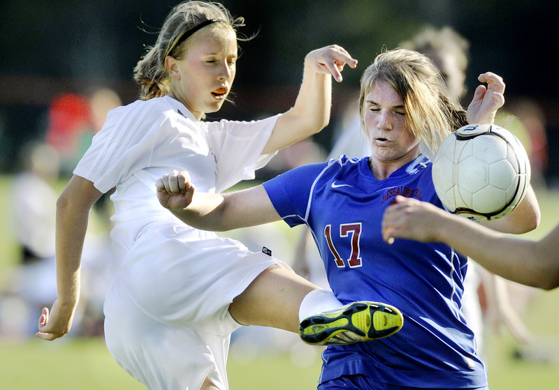 Allison Hill of Brunswick, left, tries to get off a shot while defended by Andrea Eschenbrenner of Messalonskee during Brunswick's 5-0 victory in a schoolgirl soccer game Tuesday.