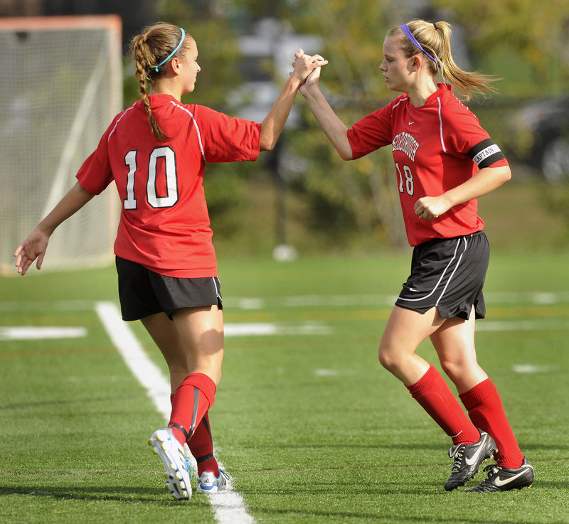 Haley Carignan of Scarborough, right, is greeted by Jessica Meader after scoring her first of three goals Wednesday in a 3-2 victory against Deering.