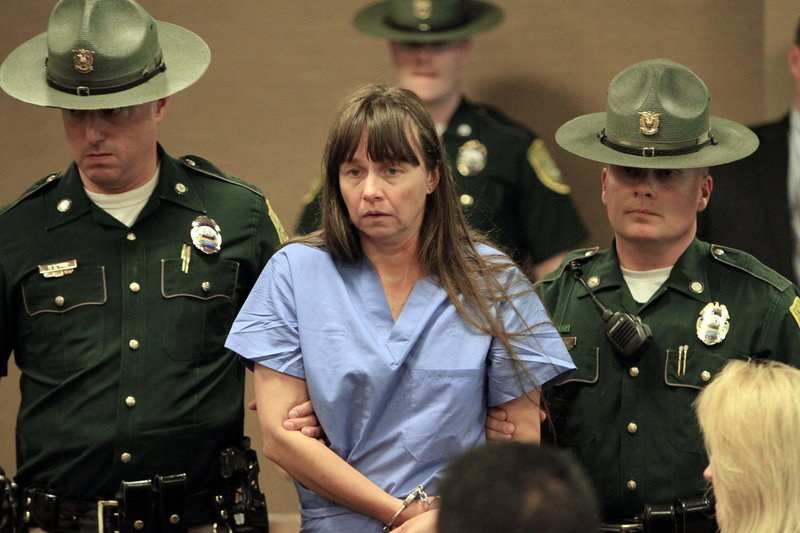 Julianne McCrery arrives in court last May in Portsmouth, N.H. Authorities and friends have portrayed the Texas woman as a loving but troubled mother, and a relative believes McCrery's intent was to take her son's life and then her own.