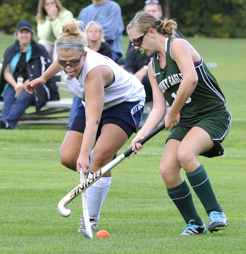 Kayla Winton of Westbrook, left, competes for the ball with Jordan Ray of Bonny Eagle during their field hockey game Wednesday. Westbrook scored in the second overtime to improve to 7-2 with a 2-1 victory at home.