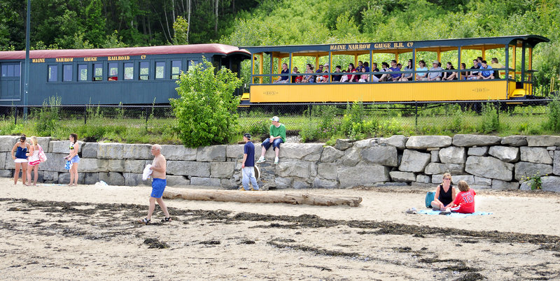 Passengers on the Maine Narrow Gauge Railroad take in a view of Portland's East End Beach. The nonprofit is planning to relocate its museum and rail yard.