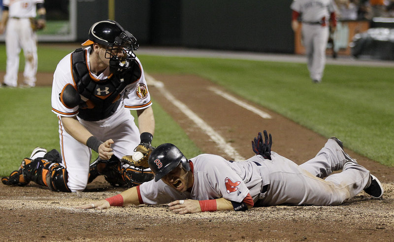 Marco Scutaro of the Boston Red Sox is out at the plate Wednesday night, tagged by Baltimore catcher Matt Wieters while trying to score in the eighth inning. The season ended for Boston, which went 7-20 in September to somehow miss the AL playoffs.