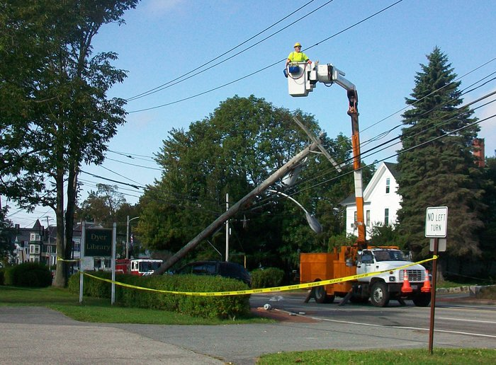 A crew from CMP works to replace a utility pole that was hit by a car on Main Street in Saco this morning. Contributed photo by Jessica Skwire Routhier.