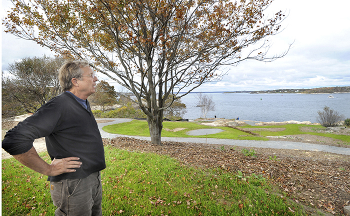 """Nate Greene shows off the first of 15 sections of a new arboretum at Fort Williams in Cape Elizabeth. The site, called """"Cliffside,"""" will be unveiled at open houses on the next two Saturdays."""