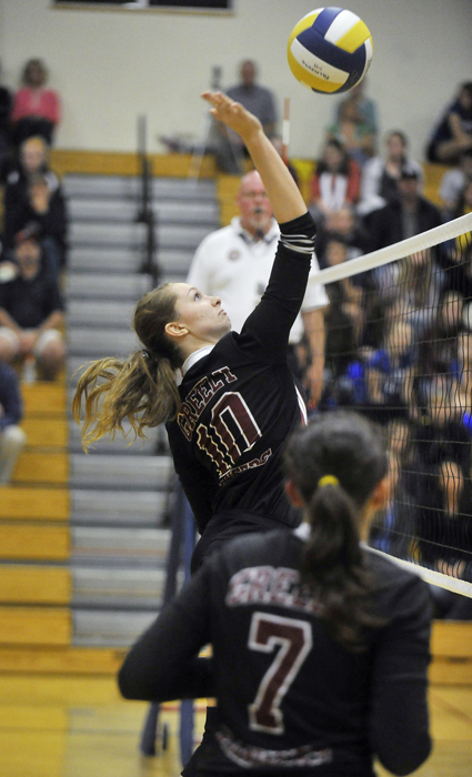 Falmouth teammates Katrina Meserve, left, and Nicole Rogers get up to block a shot by Greely. The Yachtsmen put forth a solid effort despite the absence of middle hitter Jenna Serunian because of a knee injury.