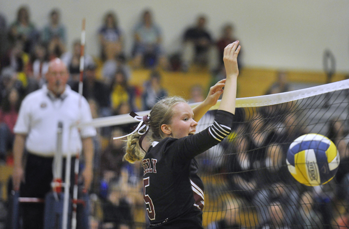 Ellie Weickert of Greely makes a block Friday night during a match against Falmouth. The Rangers swept the Yachtsmen in three games to close out the regular season at 14-0.