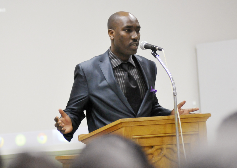 Georges Budagu speaks during a memorial service Sunday at the St. Pius X Parish Hall in Portland. His older brother was among the seven Tutsi who were tortured and murdered.