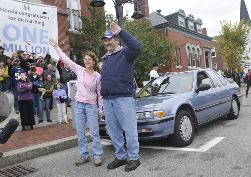 Joe LoCicero and his wife, Sharon, wave Sunday at a surprise parade in Saco to honor him for driving his 1990 Honda Accord, in background, over 1 million miles.