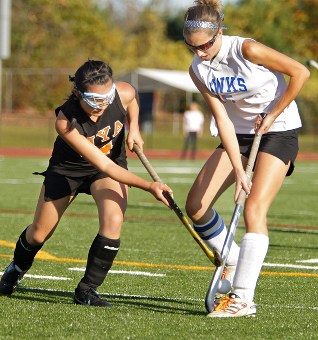 Emma Warren of North Yarmouth Academy works for the ball against Sacopee Valley's Chelsey Burnell during the Western Class C final Tuesday.
