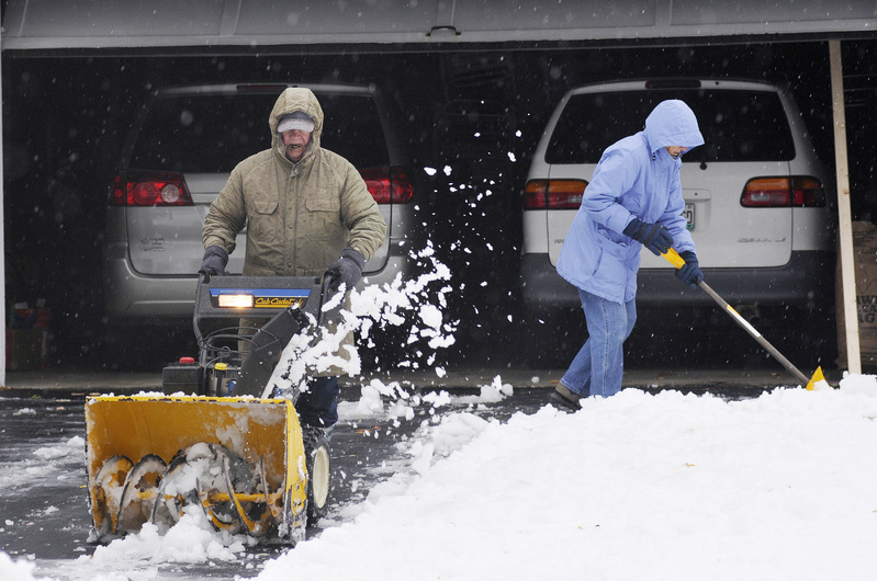Jack Colpitts snowblows his Woodcock Avenue driveway in Saco as his wife, Anita, shovels a path in front of their garage today.