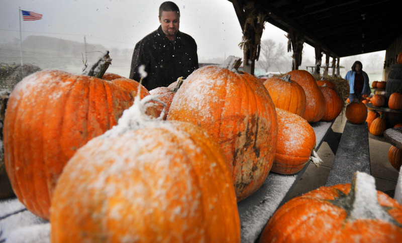 Tradition did not let a little snow stop the Sipskey family from picking the perfect pumpkins at Dymond's farm in Dallas on Saturday afternoon. The family always get's their pumpkins the weekend before Halloween and kept with that tradition this year. 10/25/20111 Aimee Dilger/The Times Leader