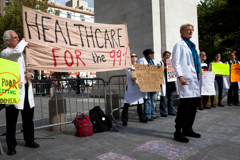 Health care workers stand in support of the Occupy Wall Street demonstration in New York on Saturday. The movement's lack of leaders has allowed varied participation.