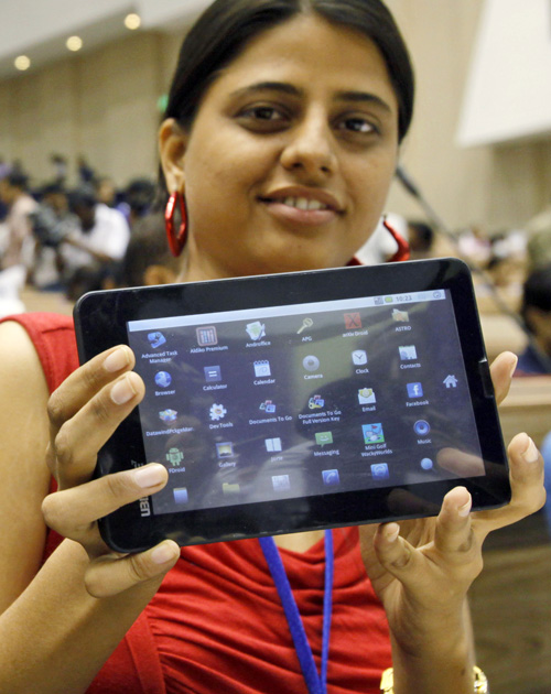 An Indian student poses with the supercheap Aakash tablet computer today. The Indian government intends to deliver 10 million tablets to students across India.