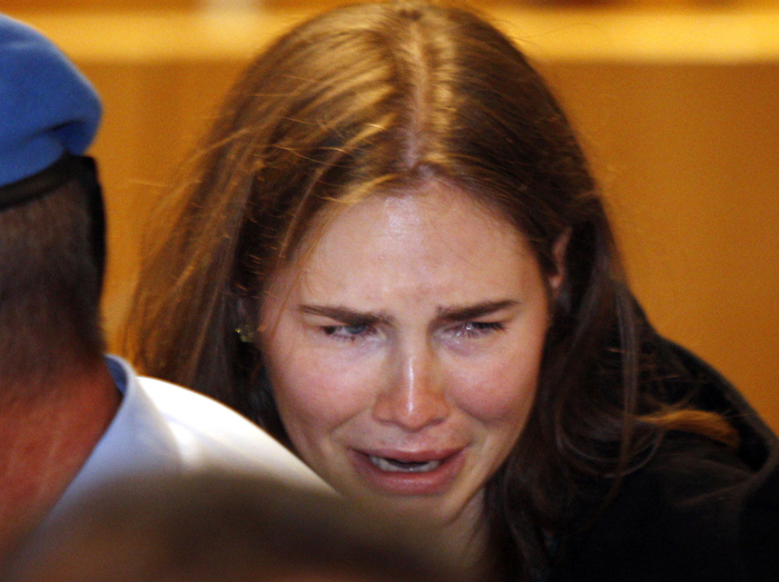 Amanda Knox breaks down in tears after hearing the verdict overturning her conviction of murdering her roommate today.