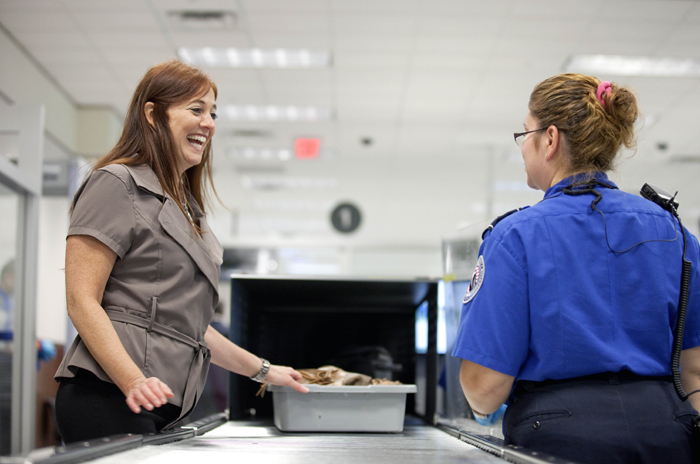 Passenger Donna Pederson, left, of Atlanta, talks with TSA officer Myra Watts after going through a new expedited security line in Atlanta today.