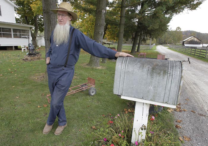 Sam Mullet, father of two of the three men arrested for allegedly going into the home of another Amish man and cutting his hair and beard, talks outside his home in Bergholz, Ohio, on Monday.