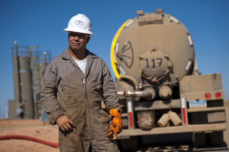 Kenny LeBaron and his brother moved to North Dakota from Minnesota to take advantage of higher salaries attributed to an oil boom. Here they service a gas and oil well near Watford City, North Dakota, last month. Industry experts say up to 24 billion barrels of oil could pumped out of the Bakken formation.