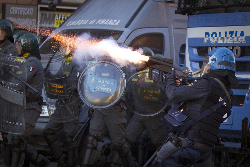 Italian police fire tear gas in Rome on Saturday as protesters turned a demonstration against corporate greed into a riot, smashing shop and bank windows, torching cars and hurling bottles.