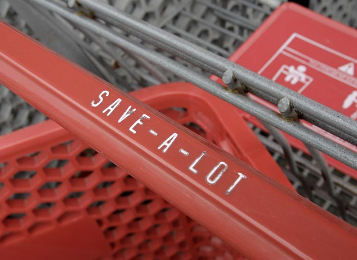 Grocery carts are stacked outside the Save-a-Lot grocery store in Northfield, Ohio. Recent reports show consumers have boosted their spending on retail goods by the most since March.