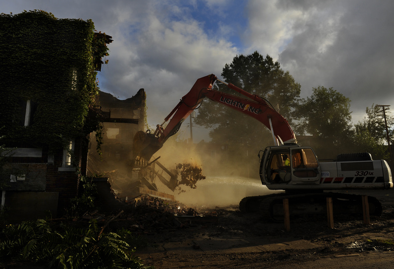An apartment building in East Cleveland is demolished in hopes it will help the remaining homes in the area retain more of their value. Banks are giving away scores of properties rather than pay the cost of maintaining them.