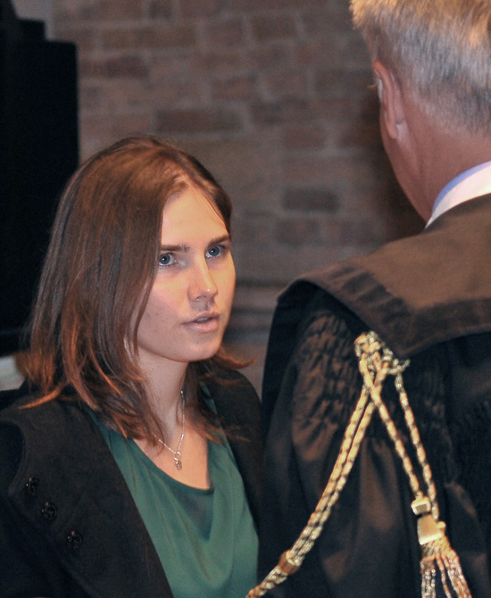 Amanda Knox talks with her lawyer Carlo Dalla Vedova upon arrival for an appeal hearing at the Perugia court, central Italy, today.