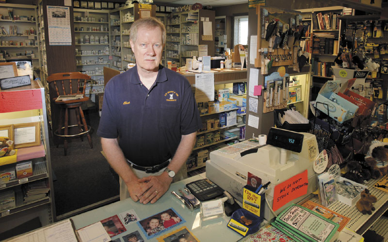 Chet Hibbard, owner and pharmacist at E.W. Moore & Sons Pharmacy in Bingham, put up signs saying he no longer stocked OxyContin after being robbed twice, once in 2006 and again in 2010. The signs didn't stop another robbery, though, that happened just hours after this photo was taken. James Stile of Sangerville was arrested and charged with robbery after police said he entered the pharmacy with a gun, tied up four employees and a customer and forced them to lie down on the floor. Police said Stile made off with prescription drugs and money.