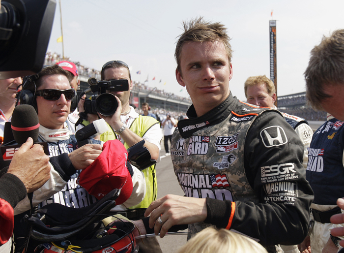 In this May 2010 photo, Dan Wheldon, speaks with reporters after finishing in second place in the Indianapolis 500 auto race at Indianapolis Motor Speedway in Indianapolis. Wheldon died Sunday in a 15-car wreck at Las Vegas Motor Speedway. He was 33.