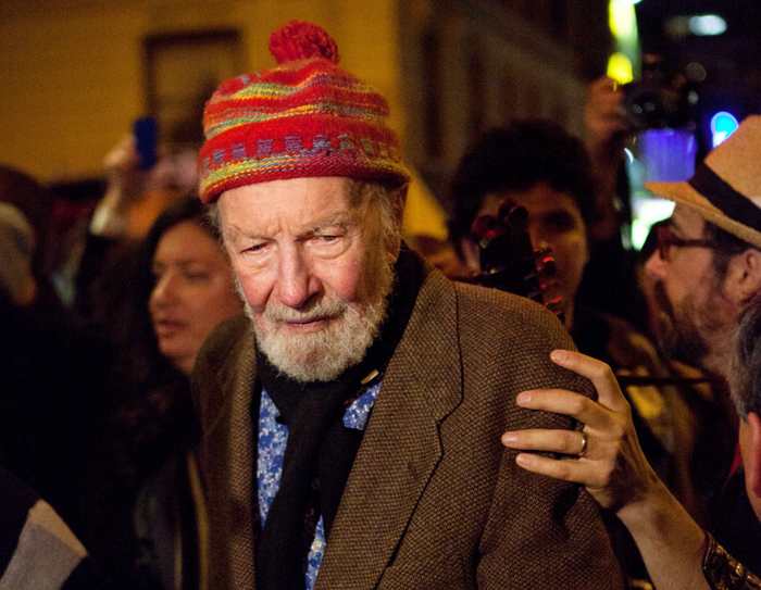 Pete Seeger, 92, exits the Symphony Space on the Upper West Side to march with nearly a thousand demonstrators sympathetic to the Occupy Wall Street protests for a brief acoustic concert in Columbus Circle on Friday.