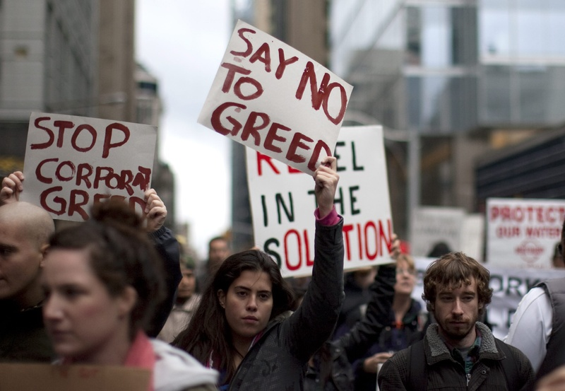 Protesters march near Toronto's financial district Saturday. The demonstration was one of many being held across the globe in support of the ongoing Occupy Wall Street demonstration in New York. Canada