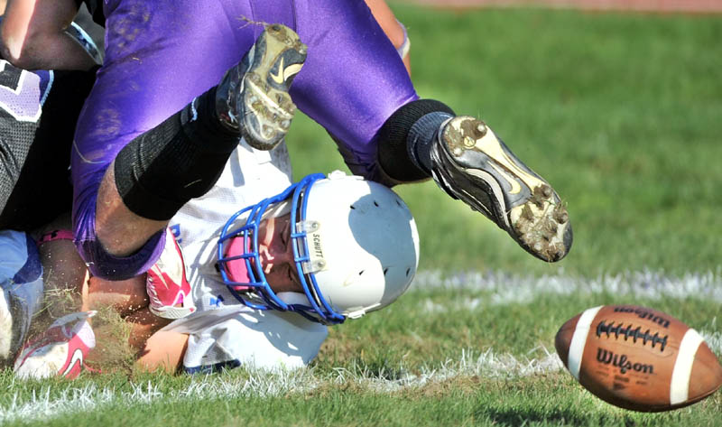 Staff photo by Michael G. Seamans Madison High School's Stephen Cusson, 15, fumbles the ball near the goal line against Waterville High School at Waterville Senior High School Saturday. Madison recovered the loose ball in the end zone for a touchdown. Waterville defeated Madison 55-36.