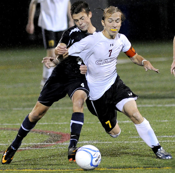 Blake Barritt of Cape Elizabeth attempts to control the ball and hold off David Murphy of Yarmouth during their Western Maine Conference soccer game Tuesday night. Yarmouth held on for a 1-0 win.
