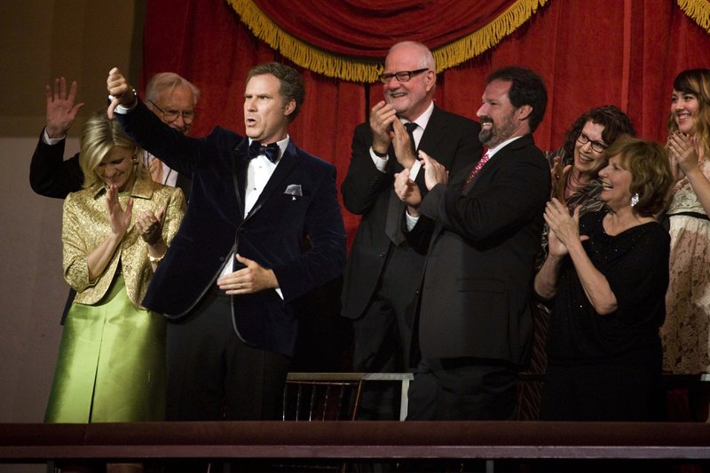 Will Ferrell, standing next to his wife, Viveca Paulson, gives a comedic thumbs down to the audience Sunday at Washington's Kennedy Center, where he received the Mark Twain Prize for American Humor.