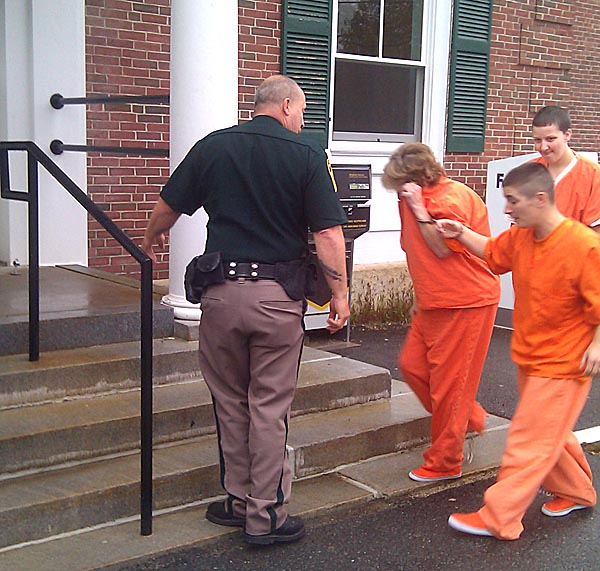 Carol Field is escorted into the courthouse in York County this morning.