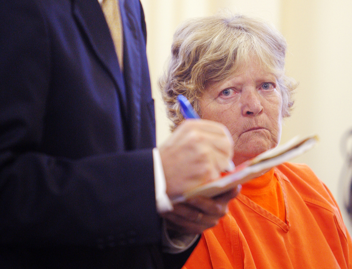Carol Field of Standish listens to her attorney, J.P. DeGrinney, during her bail hearing at York County Superior Court in Alfred today.