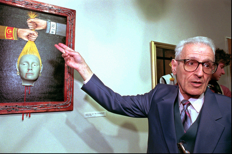 "Dr. Jack Kevorkian discusses ""Genocide"" at his show in Royal Oak, Mich., in 1997. More than 20 of his paintings will be sold."