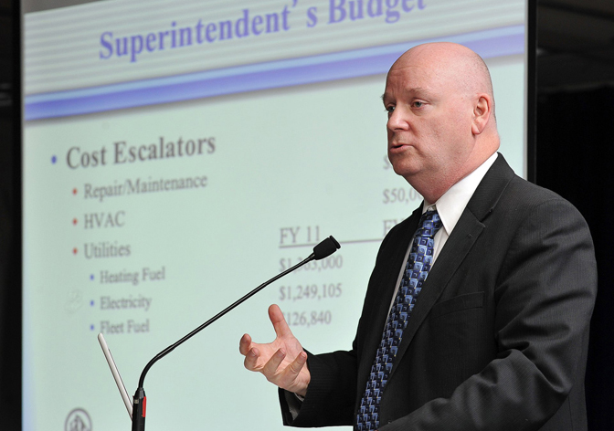 In this March 1, 2011, photo, Portland Schools Superintendent Jim Morse explains his 2011-2012 proposed budget to school committee members, teachers, staff and the public at Casco Bay High School.