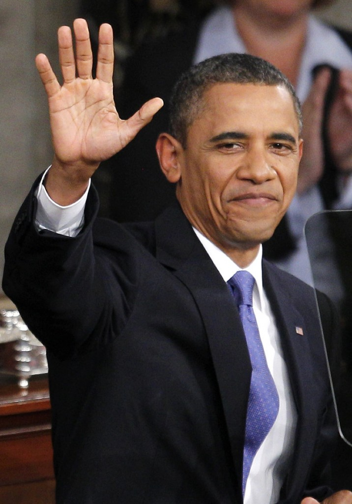 President Obama waves as he arrives to deliver a speech on job creation to a joint session of Congress on Sept. 8.