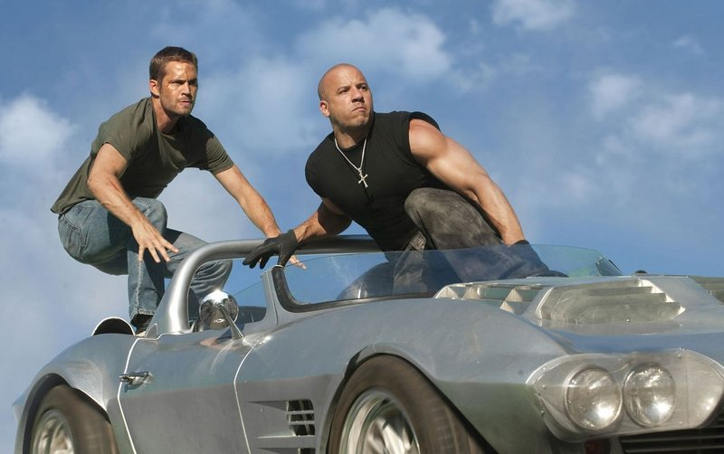 Paul Walker and Vin Diesel in Fast Five.