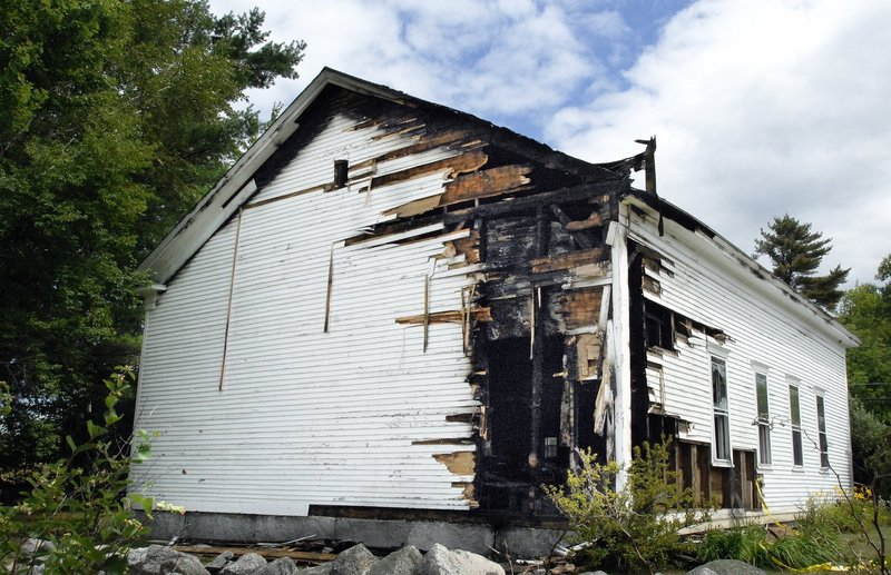 The Raymond Hill Baptist Church shows damage from an arson fire in this July 27 photo. A Standish woman is charged with setting that fire and two others.