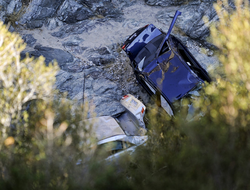 "Two vehicles sit at the bottom of a ravine in Castaic, Calif., on Friday, a day after they were discovered. The car on the right belongs to David Lavau, 67, who survived six days in the ravine. Investigators are ""99 percent sure"" that the body that was in the other vehicle is that of Melvin Gelfand, 88, the car's owner."
