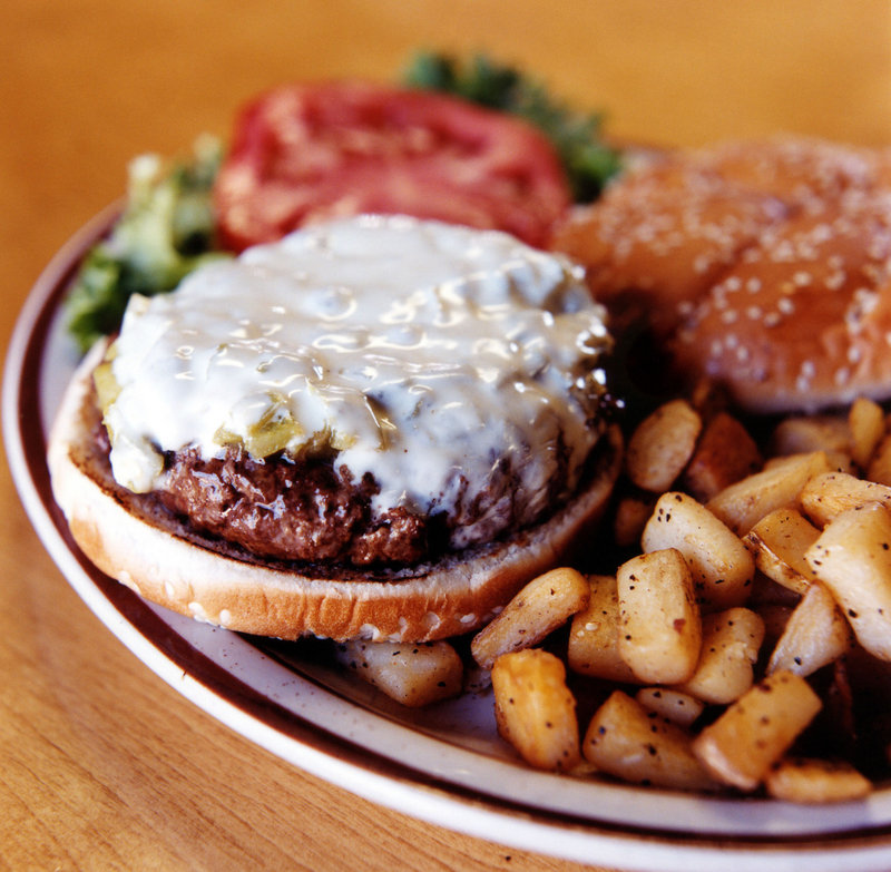 Denmark may be the first country in the world to tax fatty foods, according to a lobbying group for the nation's businesses. The tax, which took effect Saturday, will raise the price of a burger by about 15 cents.