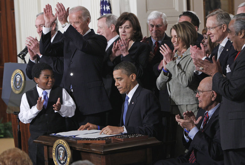 President Obama is applauded after signing the health care bill in the East Room of the White House in Washington on March 23, 2010. The Supreme Court begins its new term today, and Obama's health care overhaul, which affects almost every American, is squarely in its sights.