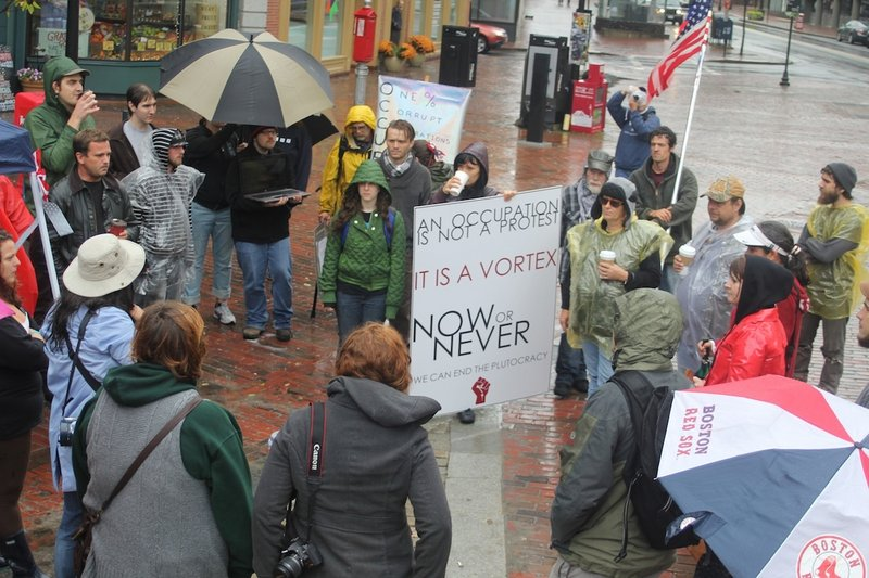 Demonstrators gather in Monument Square in Portland on Sunday as part of a nationwide protest against Wall Street.