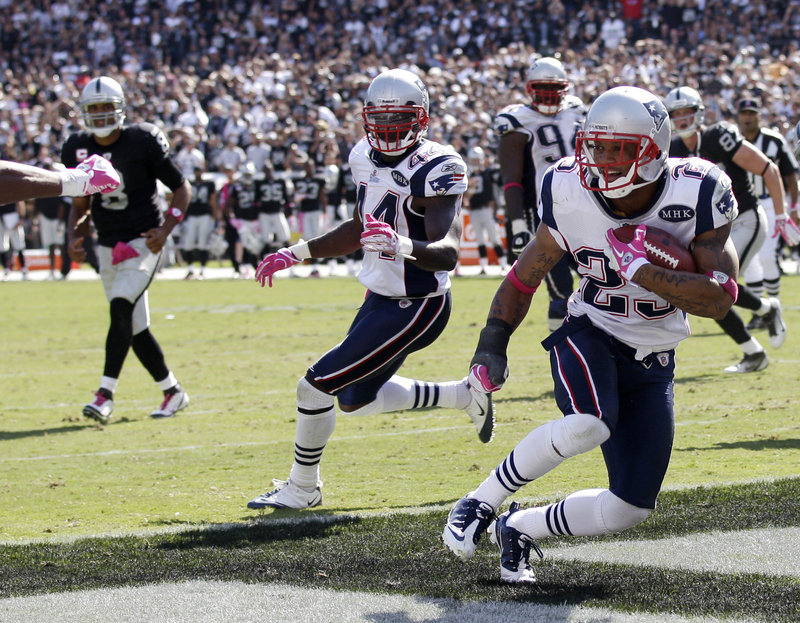 Patriots safety Patrick Chung picks off a pass in the end zone Sunday as teammate James Ihedigbo looks on. It was the first of two interceptions by New England.