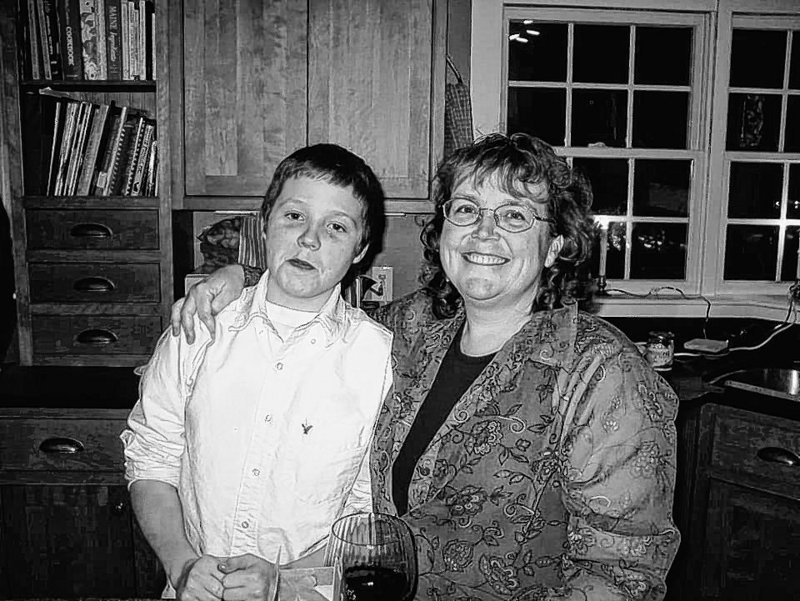 "Nancy Anne Kane and her son Ben, now 17, at a Christmas party several years ago. ""He was her rock,"" Ms. Kane's sister said."