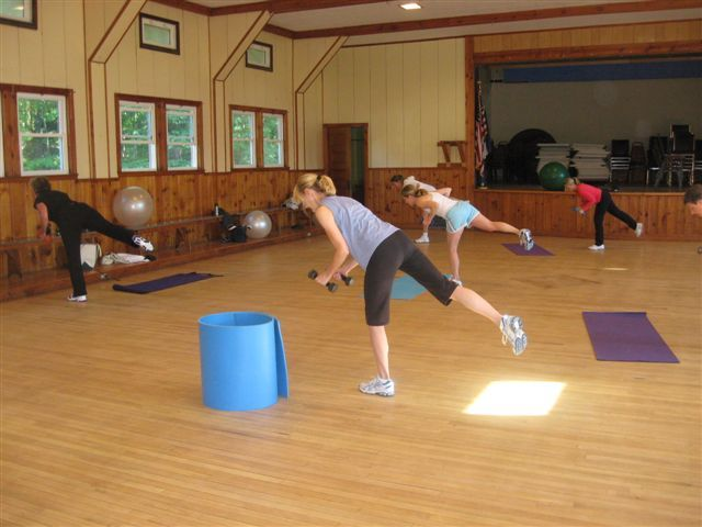 Participants in Julie Waterman's cardio strength workout class at Cumberland-North Yarmouth Adult Education work on maintaining their balance.