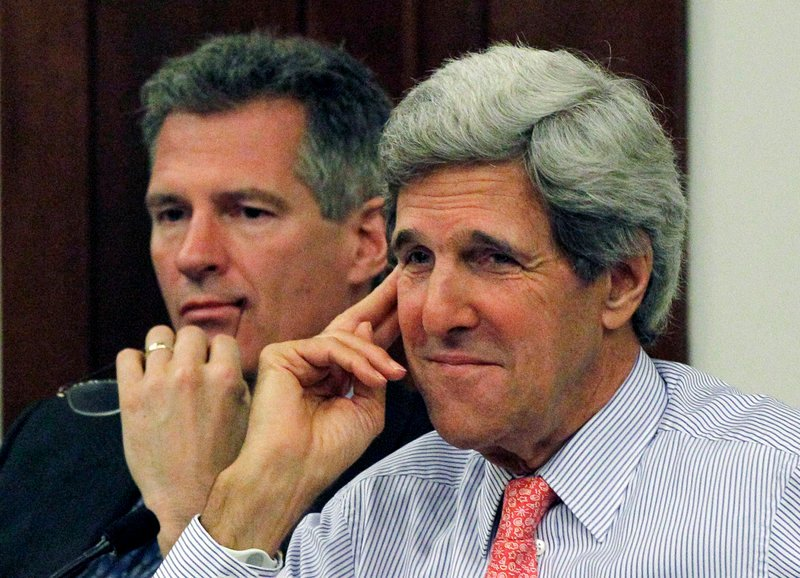 U.S. Sens. Scott Brown, R-Mass., left, and John Kerry, D-Mass. listen during a hearing at the Statehouse in Boston on the condition of the region's fishing industry.