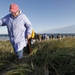 Several take a site tour of the proposed Sprague Black Point Park beach.