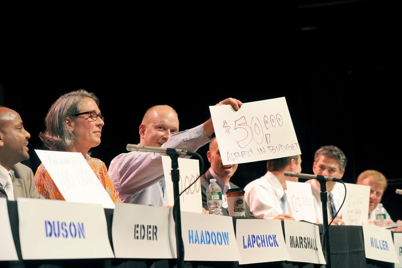 David Marshall holds up his answer to a question as the Portland Music Foundation and the Portland Arts & Cultural Center Alliance hosted the fourth mayoral forum at the State Theatre in Portland on Monday.