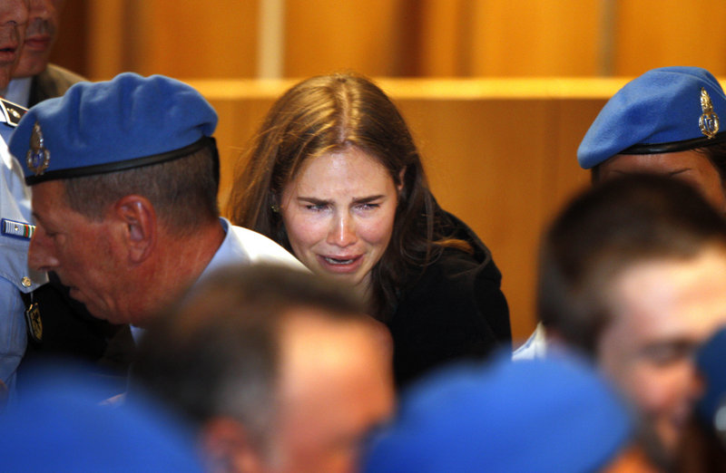 Amanda Knox breaks into tears after hearing the verdict that overturned her conviction and acquitted her of murdering her British roommate Meredith Kercher, at the Perugia court in central Italy on Monday.